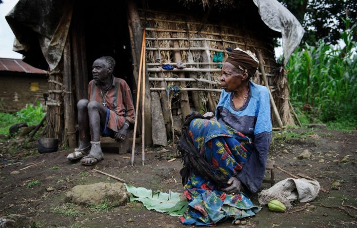 Josephu Jibesho and his wife Veronica Nyiramitana sit in the doorway to their small home in the village of Gisiza on the front line of the conflict in the Democratic Republic of Congo's North Kivu province.