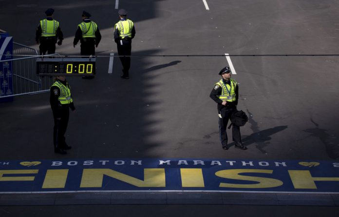 Boston police officers stand along the finish line of the Boston Marathon