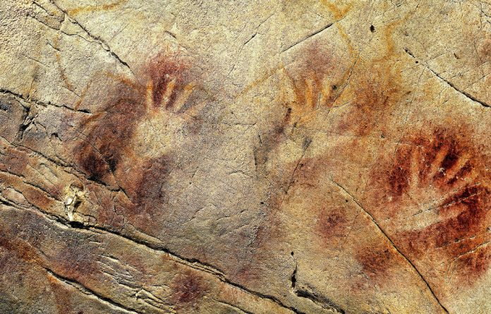 A detail of the panel of hands in the El Castillo cave in Spain