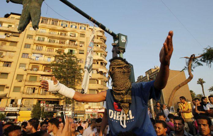 Egyptians protest against the verdicts handed down in ex-president Hosni Mubarak's murder trial in Cairo's landmark Tahrir Square.