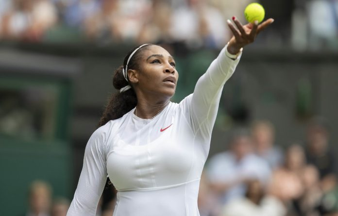 Serena Williams in action during her match against Viktoriya Tomova on day three at the All England Lawn and Croquet Club.