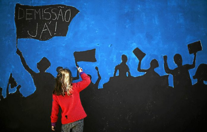 A mural in Lisbon calls for protests against austerity measures in Portugal.