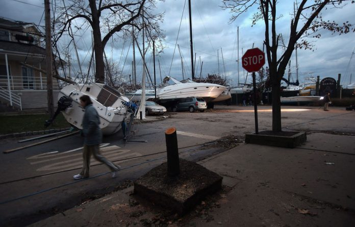 Boats pushed up by Hurricane Sandy lie against residences near a marina in the Staten Island borough of New York City. Hundreds of thousands of people in Staten Island remained without electricity in Staten Island