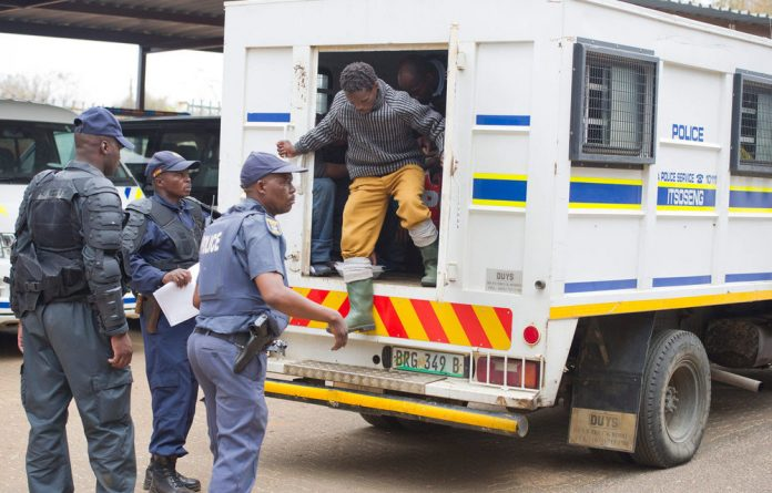 Workers arrested after the tragedy at the Marikana mine