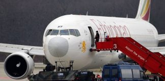 A police vehicle guards the front of the hijacked Ethiopian Airlines flight ET 702 after passengers disembarked at Cointrin Airport in Geneva.