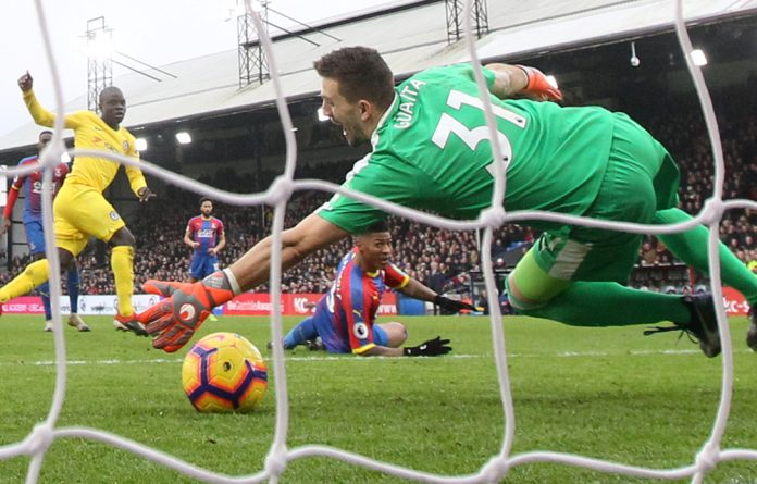 Chelsea's N'Golo Kante scores their first goal past Crystal Palace's Vicente Guaita
