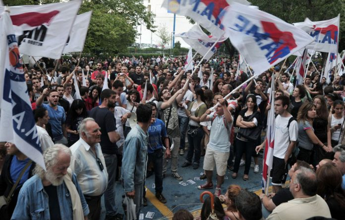 Protesters gathered outside ERT headquarters in Athens on June 12.