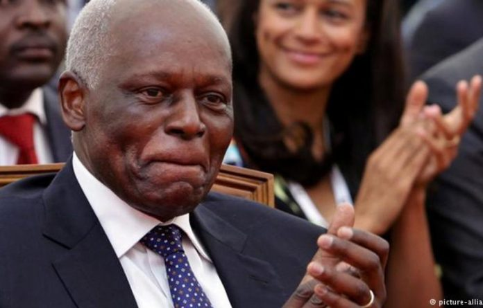 Former president Jose Eduardo dos Santos and his daughter Isabel in the background.