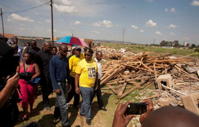 Former ANC Youth League leader Julius Malema cut a different figure when he visited Lenasia residents on Friday.