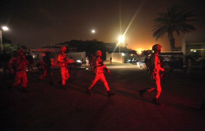 Show of force: Paramilitary soldiers arrive at Jinnah International Airport in Karachi after gunmen attacked it last week