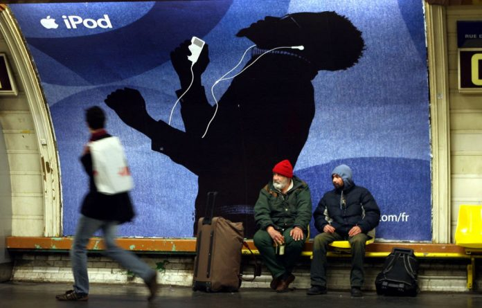 A commercial board for the iPod is seen inside a metro station in downtown Paris on March 22 2006.