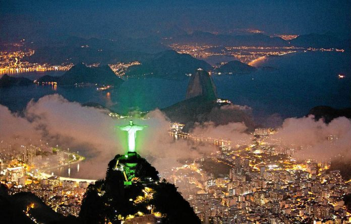 An aerial view of the Christ the Redeemer statue is lit up in green to celebrate the Rio+20 forum in Rio de Janeiro.