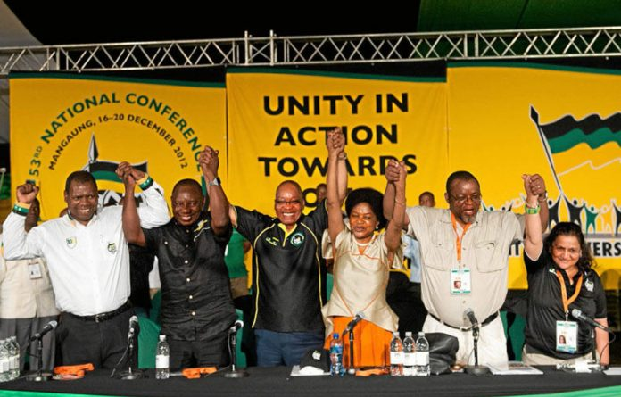 Friends for now: Jacob Zuma and his comrades celebrate in Mangaung.