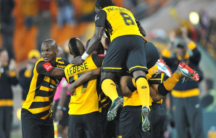 Bernard Parker of Chiefs swamped by teammates after his goal during the Absa Premiership match between Kaizer Chiefs and Black Leopards.