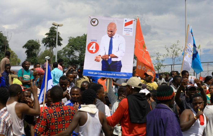 Supporters of Congolese joint opposition presidential candidate Martin Fayulu gather as he campaigns in Goma