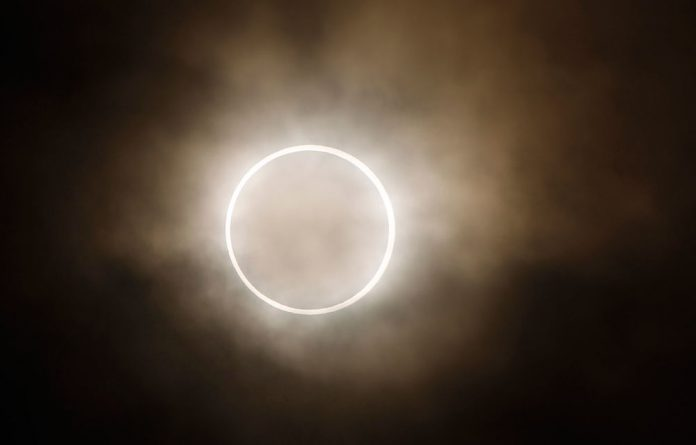 The moon slides across the sun