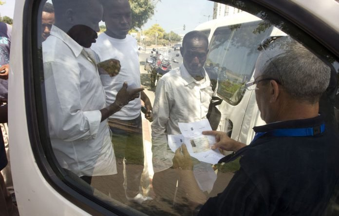 African migrants await deportation from Israel.