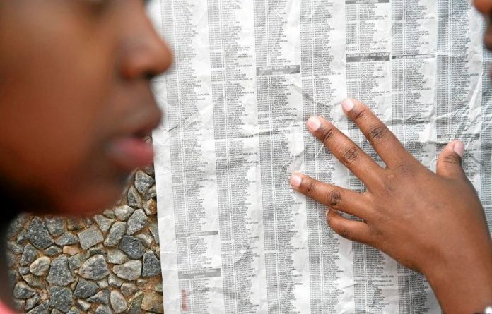Alexandra High School's class of 2013 check their matric results.