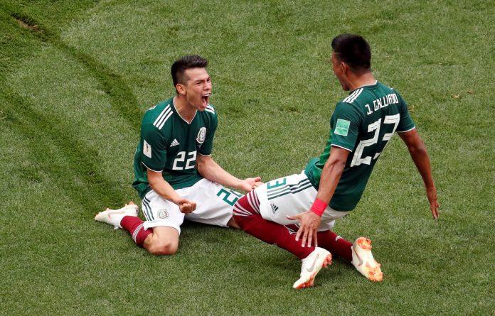 Mexico's Hirving Lozano celebrates scoring their first goal with Jesus Gallardo