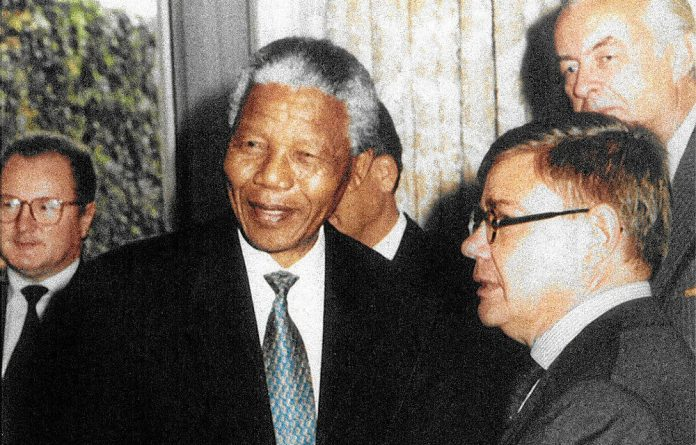 President Nelson Mandela elevated Jean-Yves Ollivier to the grade of Grand Officer of the Order of Good Hope for his peacemaking efforts.