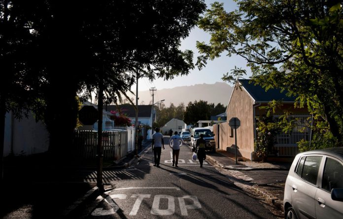 Three youngsters walking through Harfield Village could be labelled 'suspicious' on the suburb's Facebook page.