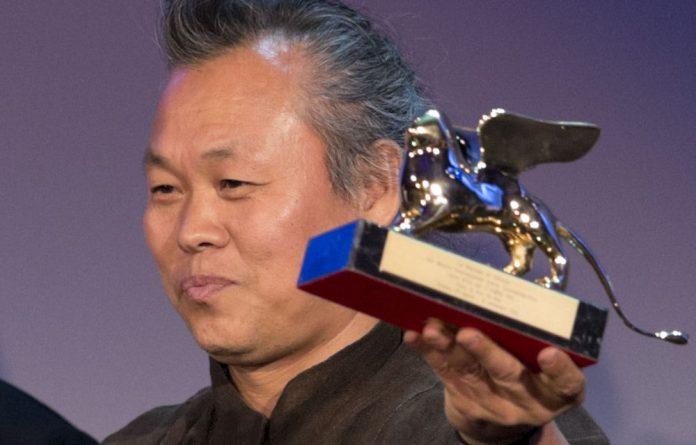 Director Kim Ki-duk displays his Golden Lion for best movie for his film Pieta at the the Venice Film Festival on September 8.