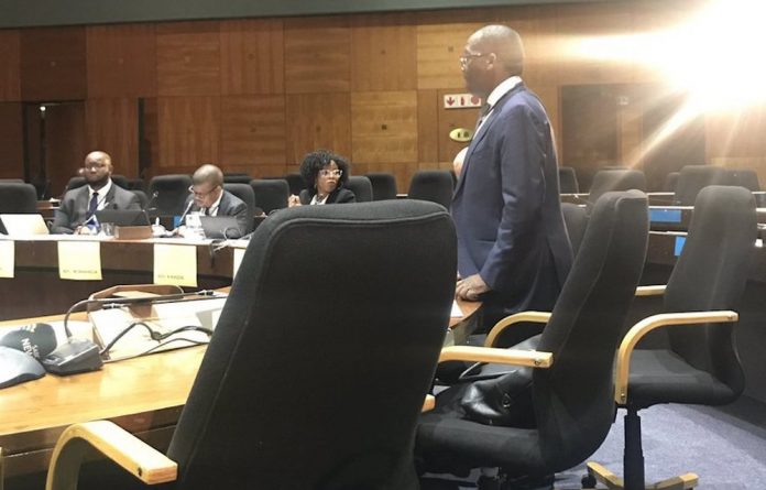 Fidelis Madavo told the commission he had received a letter this morning from the board informing him of his suspension.