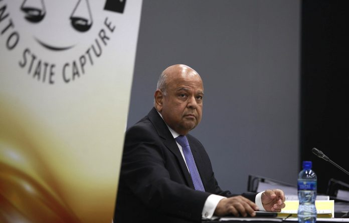Minister Pravin Gordhan at his first appearance at the Zondo Commission on Monday