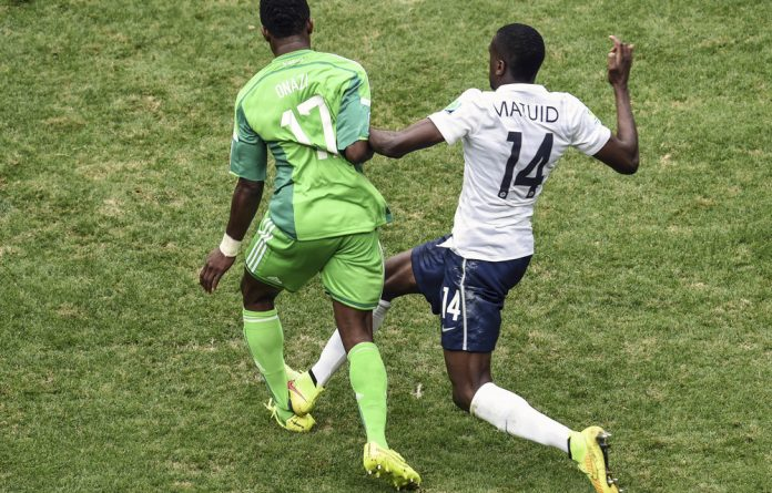 Achilles heel: Nigeria's Ogenyi Onazi was injured in a tackle made by France's Blaise Matuidi at the Brazil World Cup.