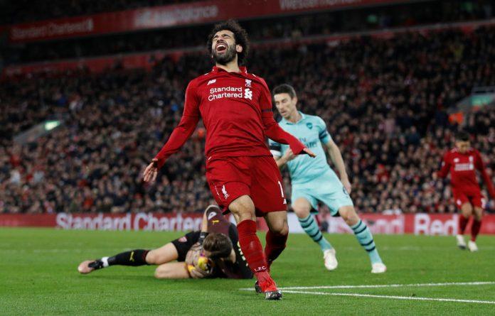 Liverpool's Mo Salah reacts after Arsenal's Bernd Leno makes a save.