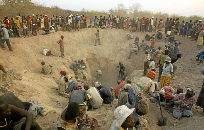 Workers sift through the Marange fields in eastern Zimbabwe.