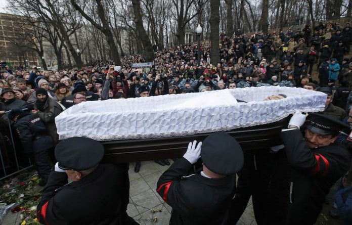 Premonition: Thousands of Russians carrying red carnations pay their last respects to slain opposition figure Boris Nemtsov