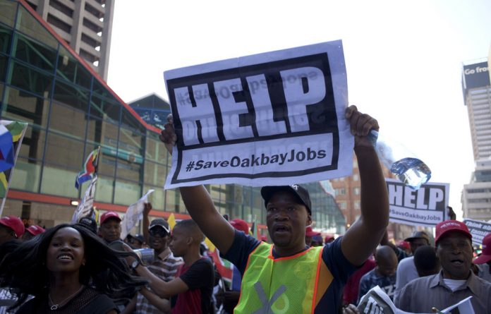 Employees of Gupta-owned Oakbay Investments marched to major banks on Tuesday to demand that the company's accounts be reopened.