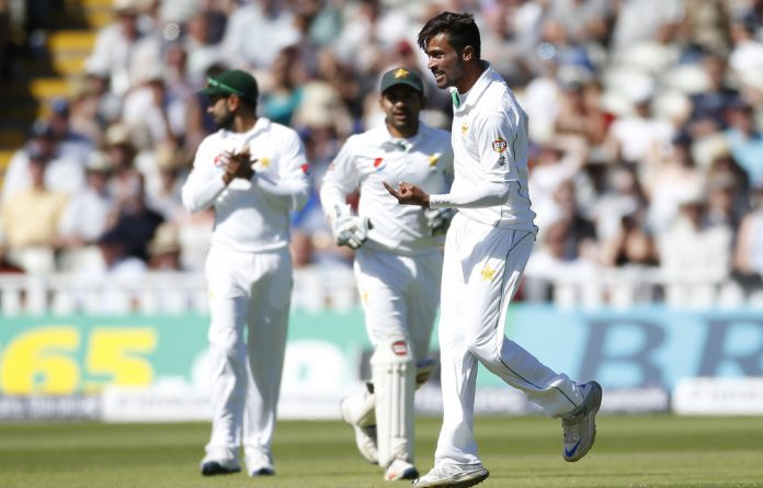 Pakistan's Mohamed Amir celebrates taking the wicket of England's James Vince.