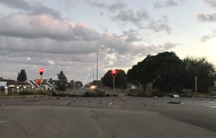 Protests against Mahumapelo brought the town to a standstill on Thursday as burning tyres and rocks were used to barricade the road.