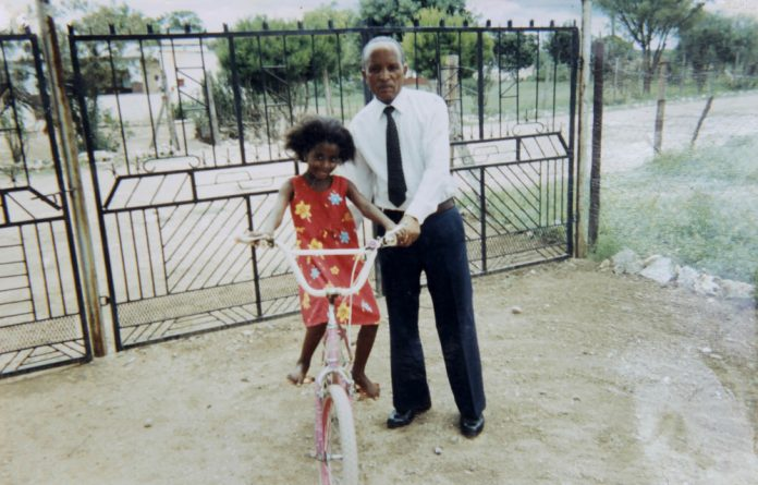 Family album: Mashadi Kekana with her father Lesiba Kekana. She felt that after his death much of the responsibility of keeping the family together fell on to her shoulders.