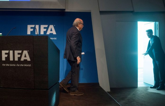 Sepp Blatter leaves after a press conference.
