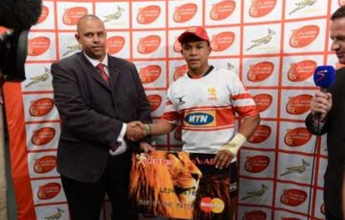 Elton Jantjies of the Lions accepting his man of the match prize during the Absa Currie Cup match between the Cheetahs and Golden Lions.
