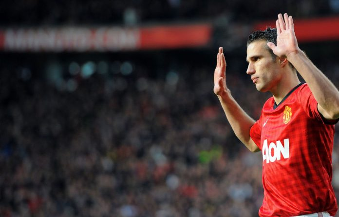 Manchester United's Dutch forward Robin van Persie celebrates scoring the first goal against Aresnal during their English Premier League football match at Old Trafford in Manchester