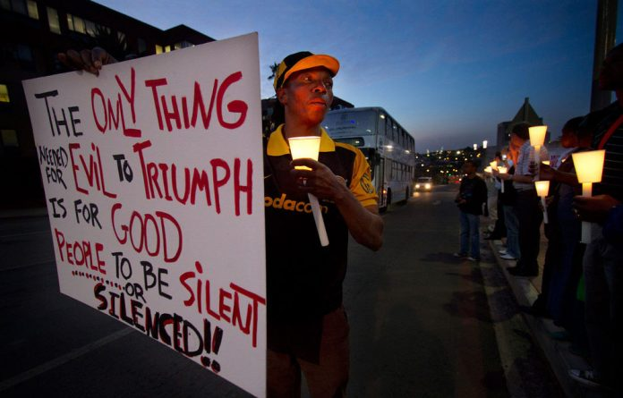 A protester against the Protection of State Information Bill takes part in a night vigil.