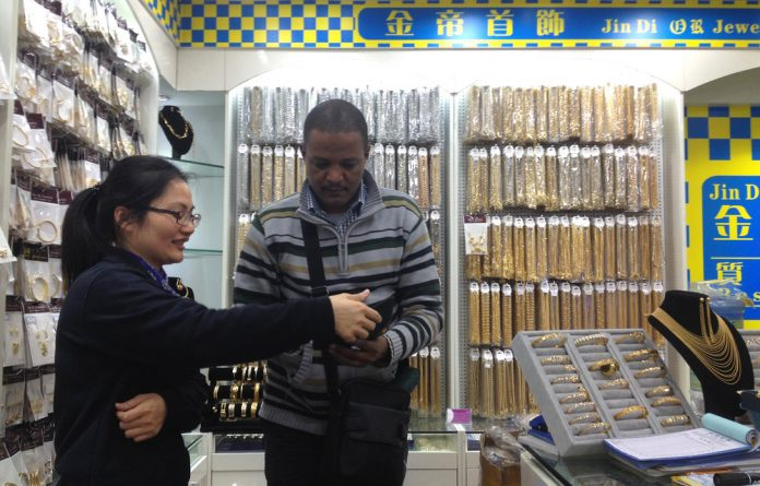 Bargains galore: A customer at a jewellery store in Xijiao market