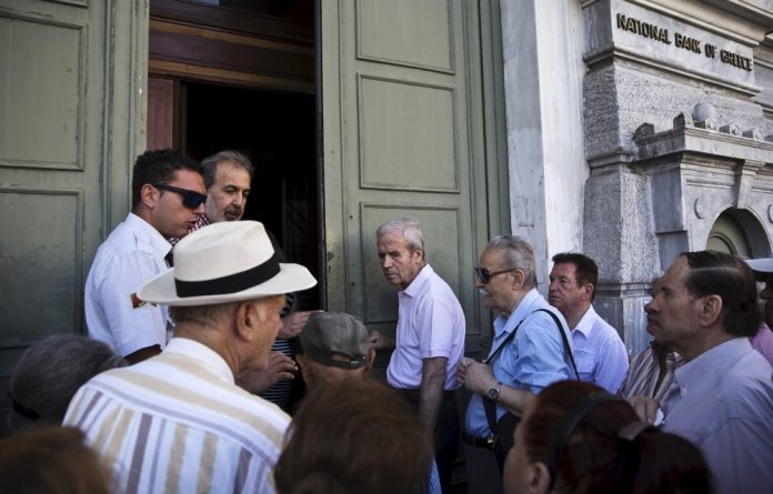 Greeks queued outside banks on Monday.