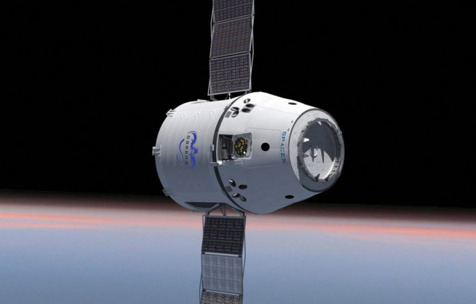 This computer generated image shows the Dragon spacecraft with solar panels deployed.
