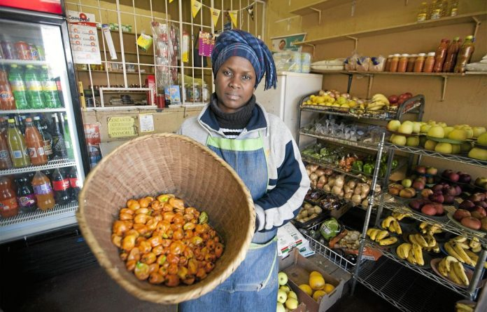 Feel the heat: Consolate Mughemuzi with the habanero chillies that she sells at her shop Get it Green and Fresh in Bez Valley