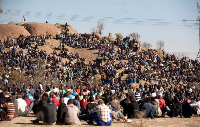 Striking Lonmin mine workers congregated on a koppie outside the Platinum mine in Marikana.