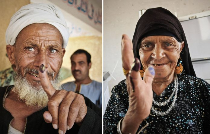 Members of the public vote in Egypt.
