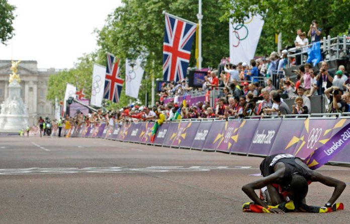 Stephen Kiprotich of Uganda celebrates after he crossing the finish line to win the men's marathon at the 2012 Summer Olympics in London.