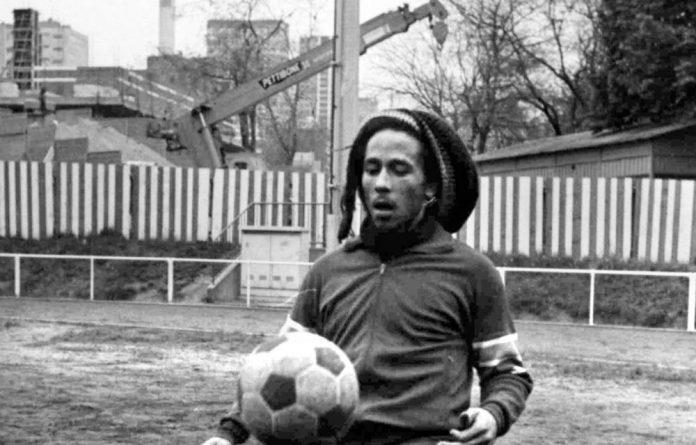 Football fan: Bob Marley practises his ball skills in Paris in 1977.