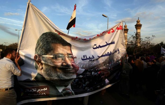 President Mohamed Morsi's declaration of legal immunity was an authoritarian tactic.