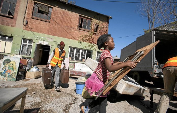 Residents leave 7 Saratoga Avenue after a long battle with the City of Johannesburg to provide alternative